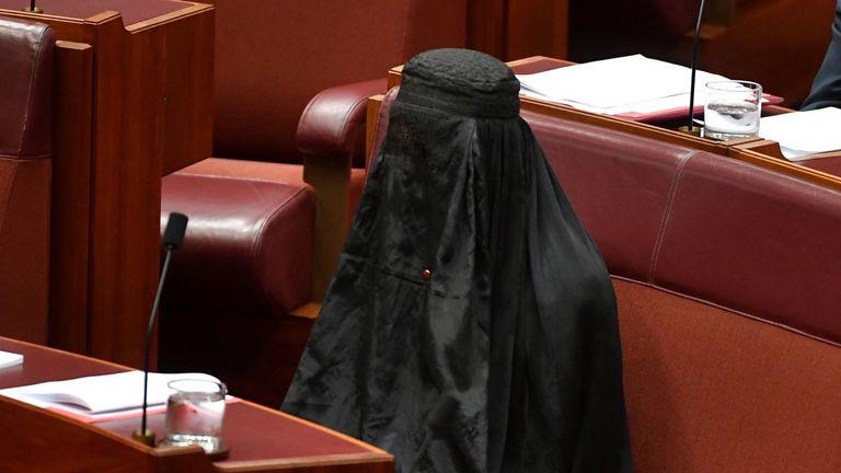 Australian One Nation party leader, Senator Pauline Hanson wears a burqa in the Senate chamber