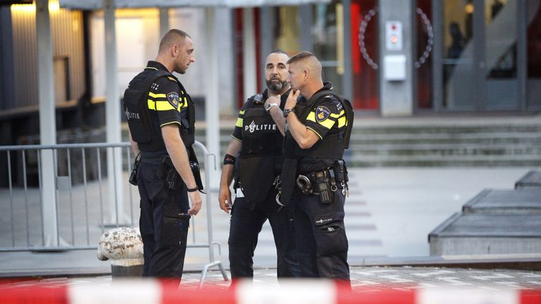 Police stand during the evacuation the Maassilo concert venue after a concert by Californian ban Allah-Las was canceled in relation to a terror attack threat