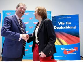 Nigel Farage speaks at an event held by the German right-wing, populist Alternative for Germany (AfD) political party  as AfD leading member Beatrix von Storch looks