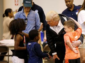 U.S. President Donald Trump and first lady Melania Trump visit with flood survivors of Hurricane Harvey at a relief center in Houston, Texas, U.S., September 2, 2017. REUTERS/Kevin Lamarque