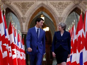 Canada's Prime Minister Justin Trudeau (L) and Britain's Prime Minister Theresa May