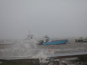 Boats remain anchored in a wharf as Hurricane Maria approaches in Guadeloupe island