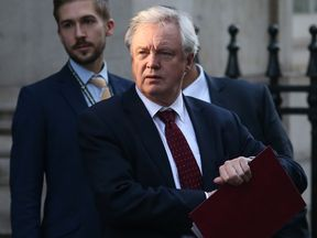 British Secretary of State for Exiting the European Union (Brexit Minister) David Davis, leaves Downing Street in central London on January 24, 2017