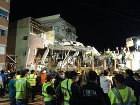 Rescue teams look for people trapped in the rubble at the Enrique Rebsamen elementary school