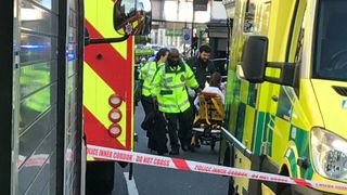 Emergency personnel attend to a person after an incident at Parsons Green underground station in London