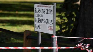 A Police cordon is tied round a local street sign at Parsons Green Underground Station