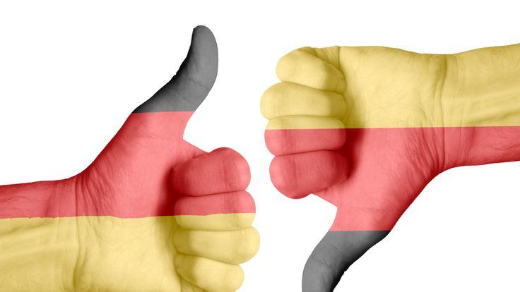 German flag on human hands - Stock image