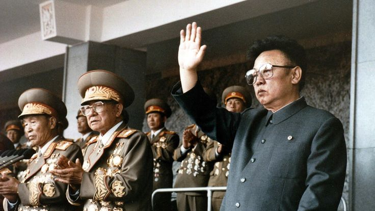 This file photo taken on October 10, 1995 shows North Korean leader Kim Jong-Il (R) waving at a military parade to celebrate the 50th anniversary of the founding of the Workers' Party of Korea (WPK)