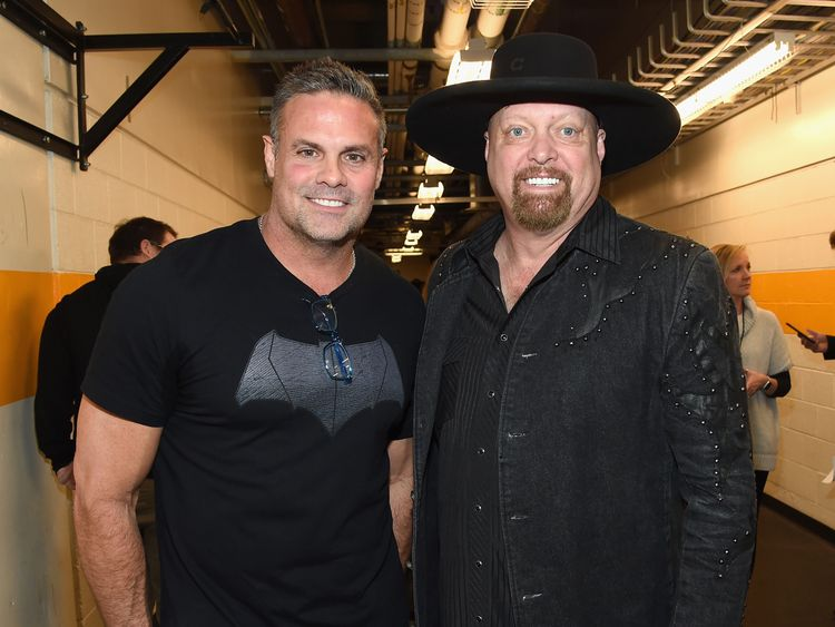 NASHVILLE, TN - FEBRUARY 08: Troy Gentry and Eddie Montgomery of Montgomery Gentry backstage during 1 Night. 1 Place. 1 Time: A Heroes & Friends Tribute to Randy Travis at Bridgestone Arena on February 8, 2017 in Nashville, Tennessee. (Photo by Rick Diamond/Getty Images for Outback Concerts)
