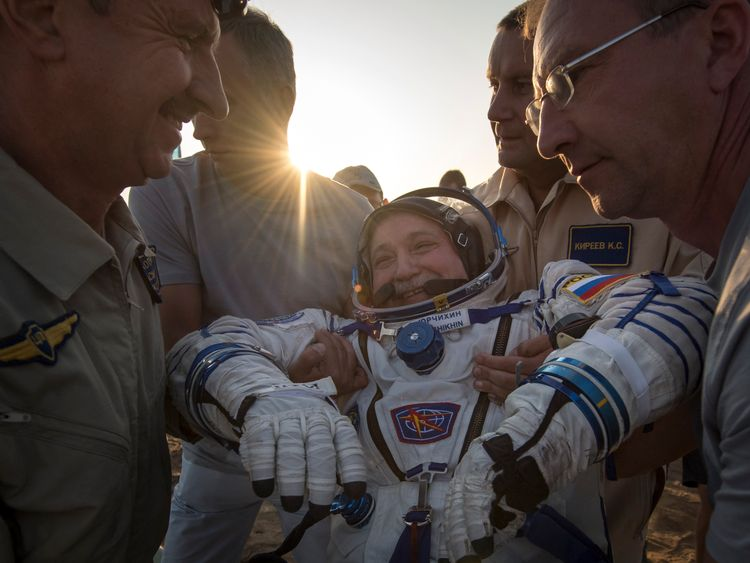 In this handout photo provided by NASA, Expedition 52 Roscosmos cosmonaut Fyodor Yurchikhin is helped out of the Soyuz MS-04 spacecraft just minutes after he and NASA astronauts Peggy Whitson, and Jack Fischer landed in a remote area near the town of Zhezkazgan, Kazakhstan on Sunday, Sept. 3, 2017 (Kazakh time)