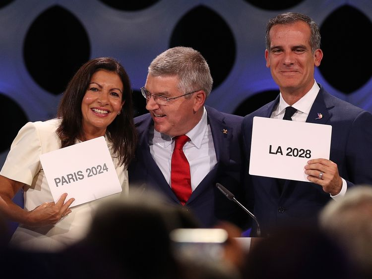 LIMA, PERU - SEPTEMBER 13: Paris Mayor Anne Hidalgo, IOC President Thomas Bach and Los Angeles Mayor Eric Garcetti react after the confirmation of the tripartite agreement which awards Paris and LA with the Olympic Games of 2024 and 2028 during the 131th IOC Session - 2024 & 2028 Olympics Hosts Announcement at Lima Convention Centre on September 13, 2017 in Lima, Peru. (Photo by Buda Mendes/Getty Images)