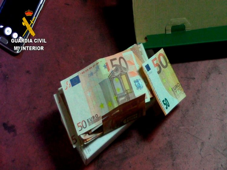 More than 100,000 euros was also seized during the anti-drugs swoop. Pic: Spanish Civil Guard