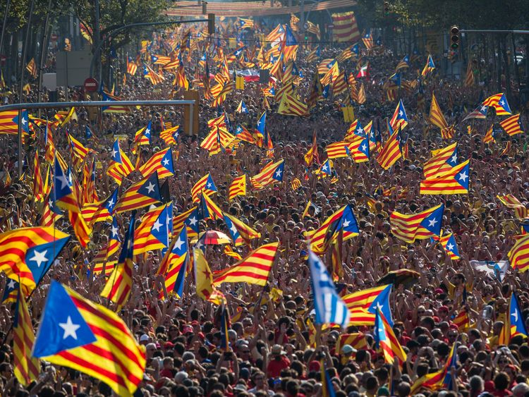 Demonstrators march in support of Catalonian independence on 11 September 2017