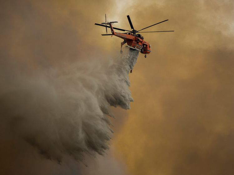 An Erickson Air Crane firefighting helicopter drops water over the La Tune Fire on September 2, 2017 near Burbank, California