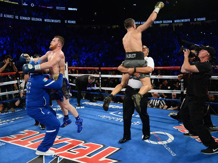 Gennady Golovkin (R) and Canelo Alvarez (L) both celebrate at the end of the bout