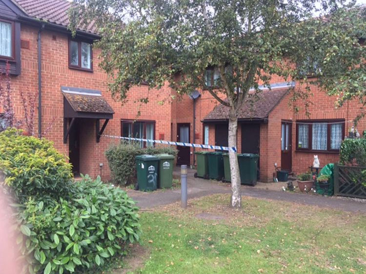 Police tape was seen outside the property in Stanwell