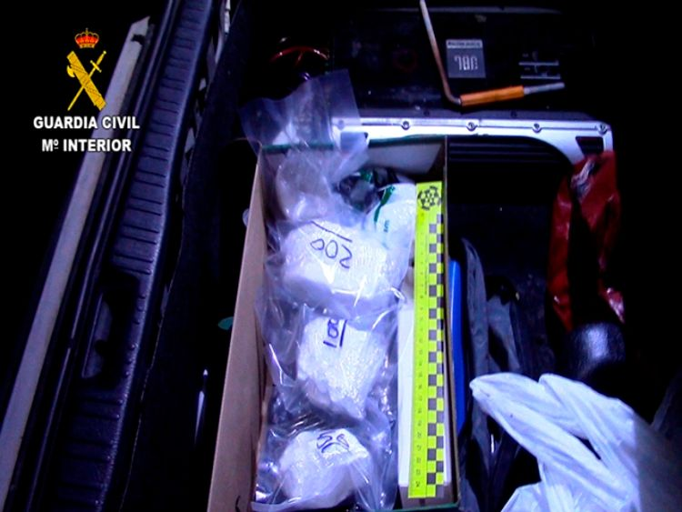 Bundles of cocaine wrapped in film were found in a box. Pic: Spanish Civil Guard