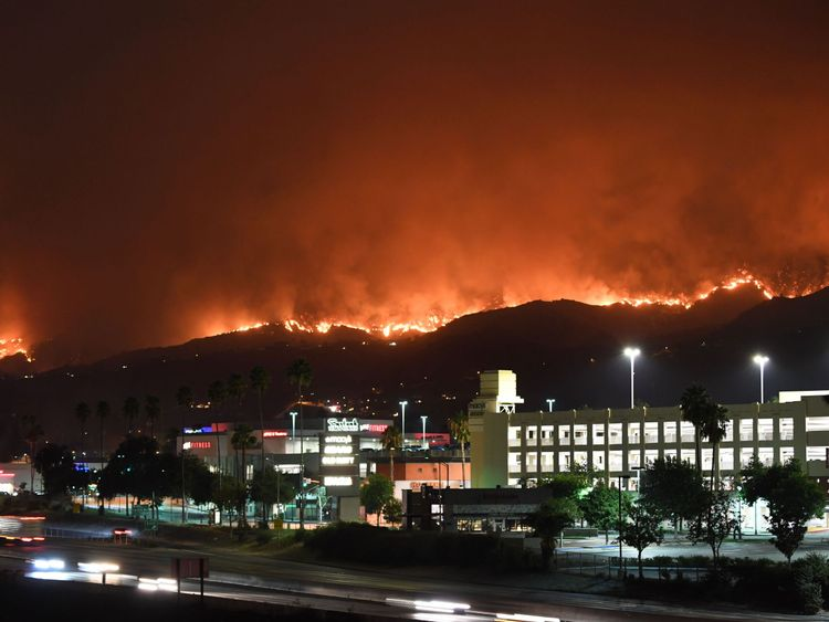 The La Tuna Canyon fire burns in the hills above Burbank, California, early September 2, 2017