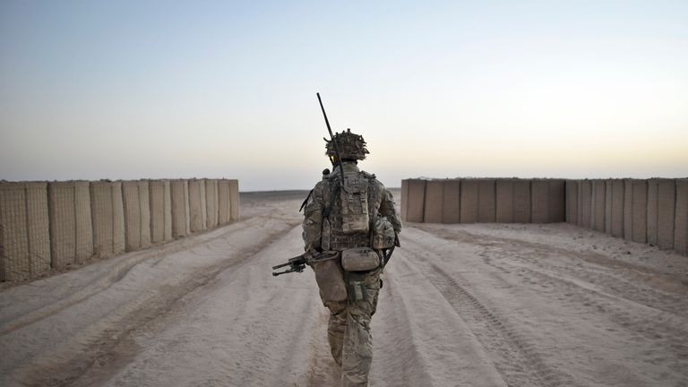A soldier from the 1st Battalion Royal Regiment Fusiliers leaves the security of the camp walls to conduct a dawn foot patrol in the Nahr-e Saraj district, Helmand Province, Afghanistan after leaving base Sterga 2. PRESS ASSOCIATION Photo. Picture date: Saturday October, 5, 2013. See PA story DEFENCE Afghanistan. Photo credit should read: Ben Birchall/PA Wire