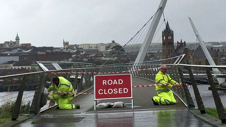 Staff from the Northern Ireland Road Service close the Peace Bridge in Londonderry, as Hurricane Ophelia hits the UK and Ireland with gusts of up to 80mph.  Autumn weather Oct 16th 2017
