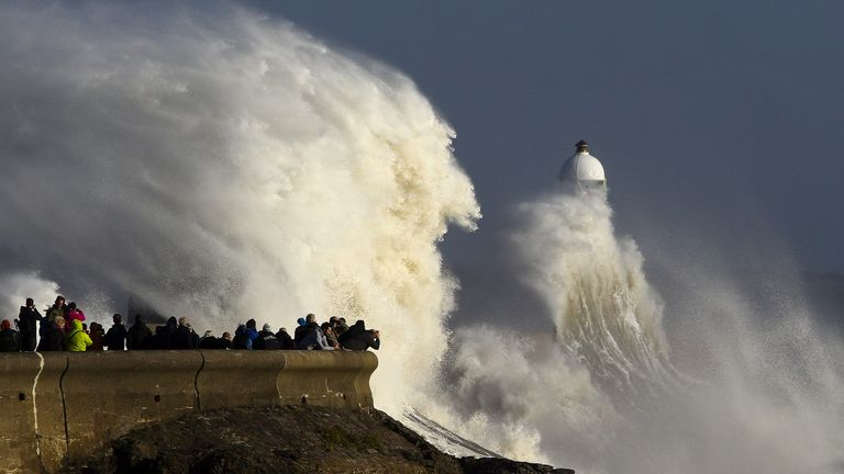 Huge waves strike the harbour wall and lighthouse at Porthcawl, south Wales