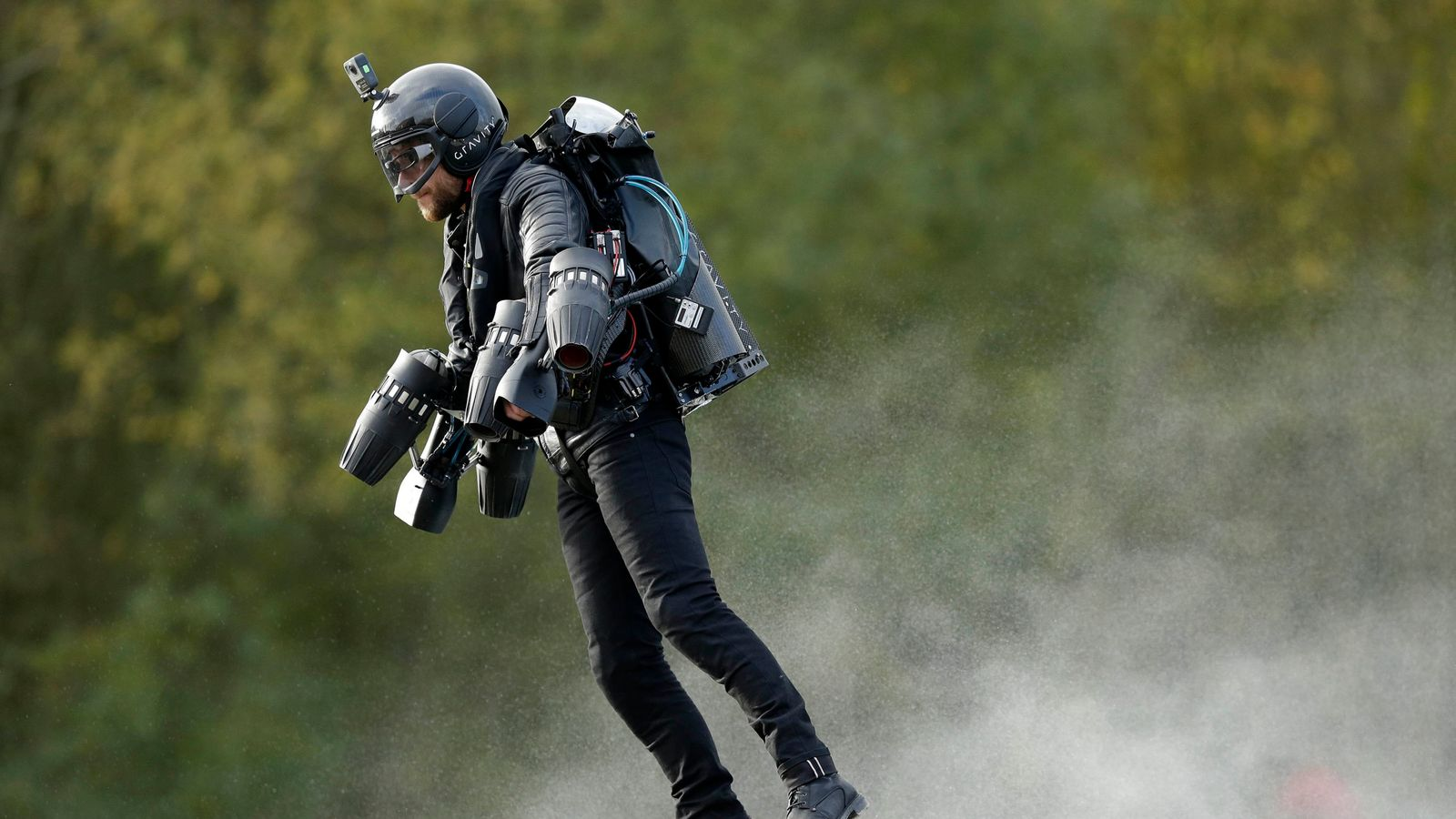 Richard Browning sets world record in jet engine 'Iron Man' suit. A real-life flying man reaches a speed of 32mph to set a world record with his body-controlled jet engine power suit.