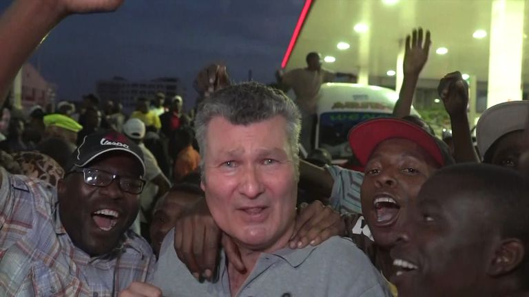 Sky's senior correspondent David Bowden mobbed by ecstatic crowds in Harare.