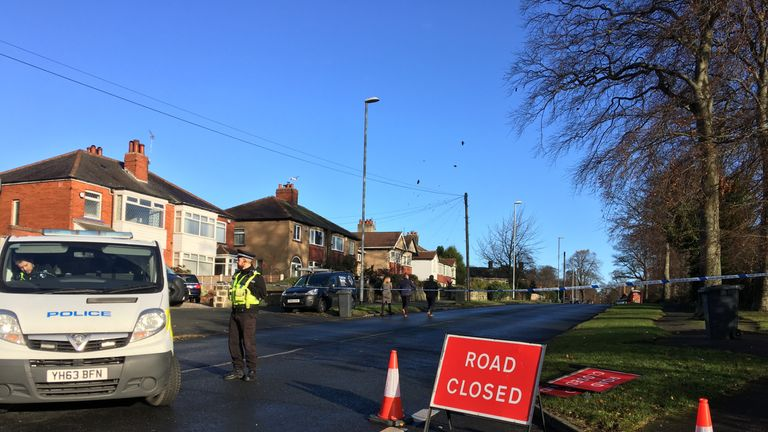 Police at the scene of a car crash in Leeds that left five people dead