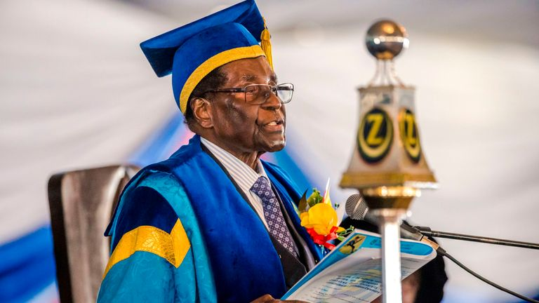 Zimbabwe's President Robert Mugabe delivers a speech during a graduation ceremony at the Zimbabwe Open University
