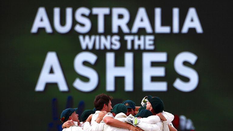 Australia's players celebrate after reclaiming the Ashes in the third test