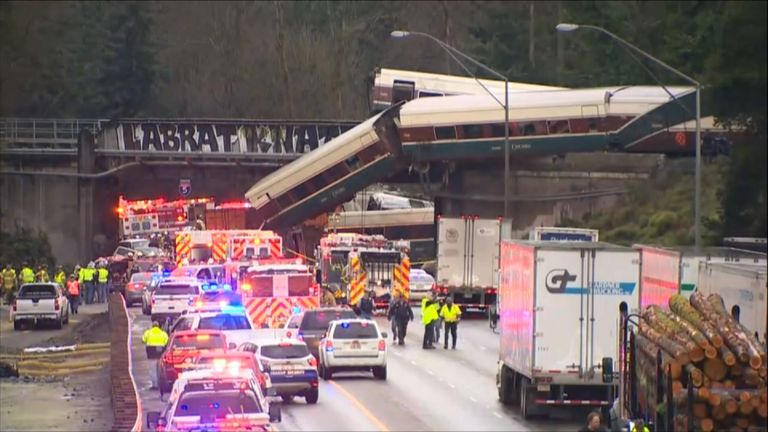 Amtrak carriages fell onto the highway below during the train's first journey on a new track.