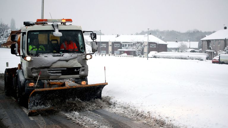 A snow plough working to clear roads in Ironbridge in Shropshire
