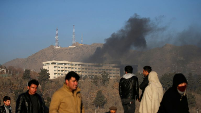 Smoke rises from the Intercontinental Hotel during an attack in Kabul, Afghanistan January 21, 2018.  REUTERS/Mohammad Ismail - RC1DEB10F2E0