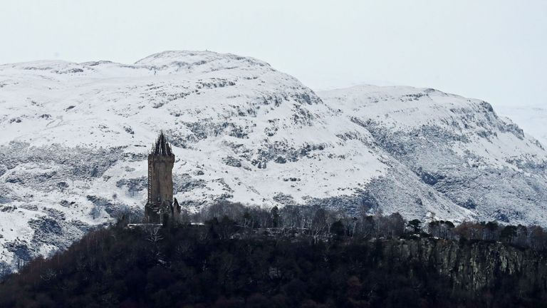 The snow-covered Ochil Hills behind the Wallace Monument in Stirling