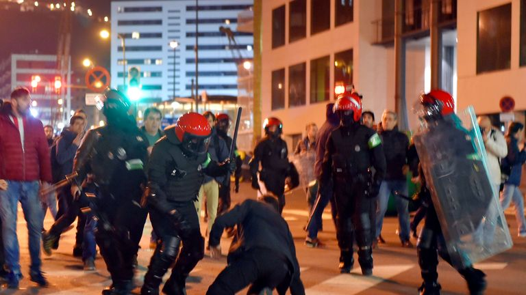 Basque autonomous police officers break up a group of Athletic Bilbao fans outside the San Mames stadium