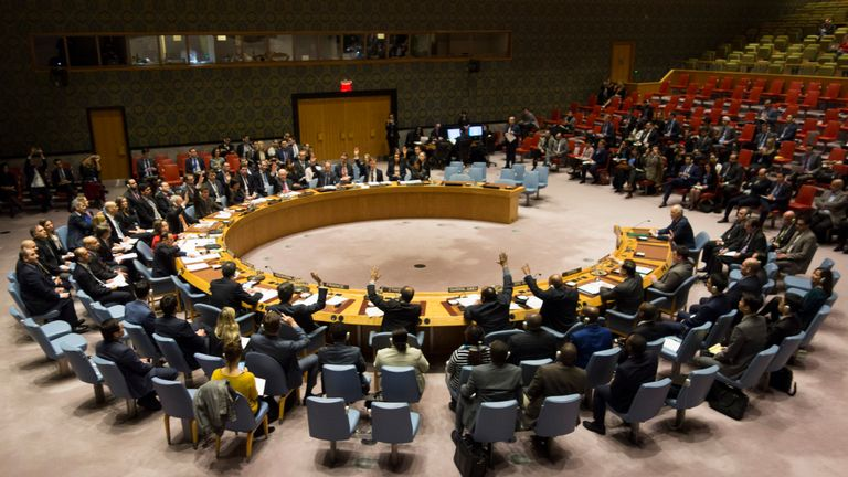 Members of the Security Council vote during a meeting on a ceasefire in Syria