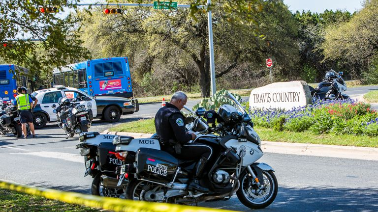 Police tape marks off the neighbourhood where a package bomb went off in Austin, Texas