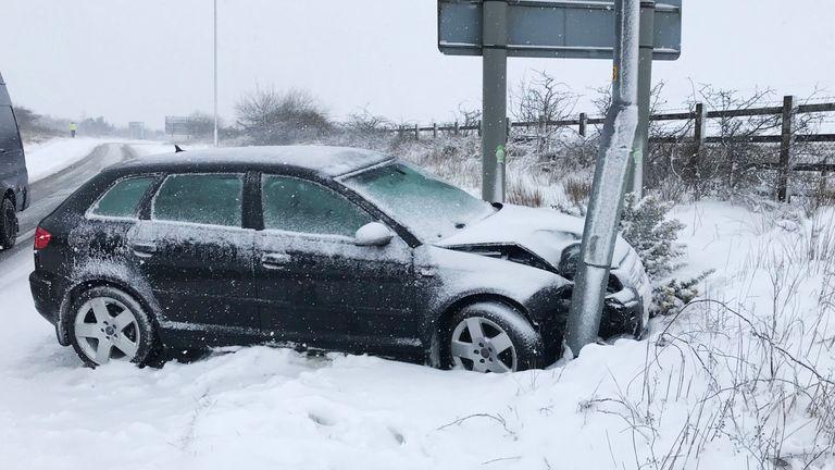 A car crashes off the A30 near Okehampton in Devon after heavy snow