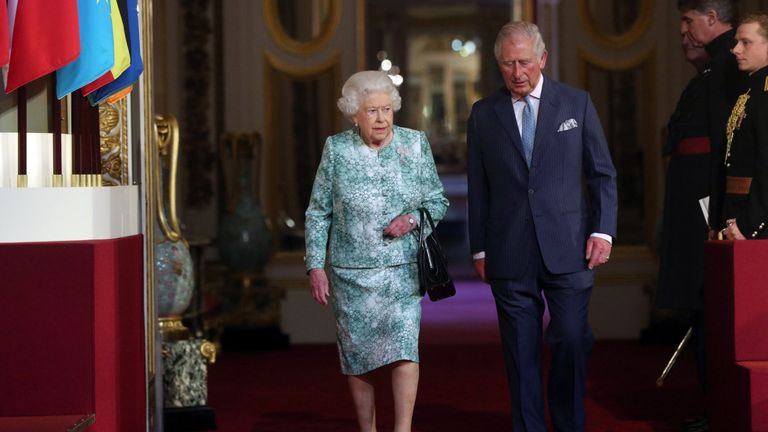 Queen Elizabeth and Prince Charles arrive for the formal opening of the Commonwealth Heads of Government Meeting
