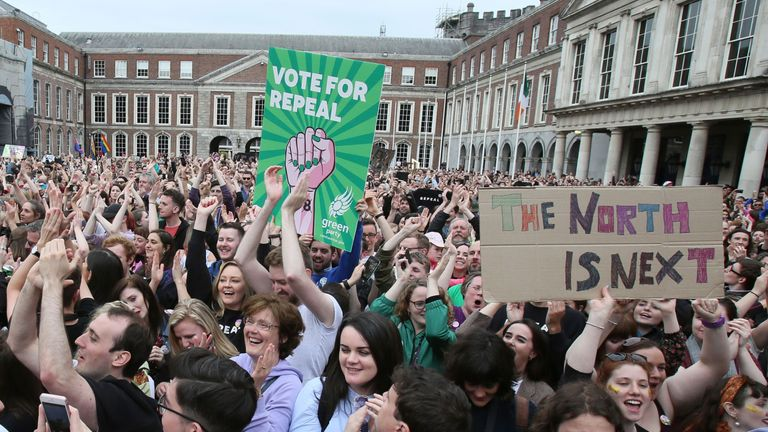Yes campaigners hold posters calling for Northern Ireland to liberalise its strict abortion laws