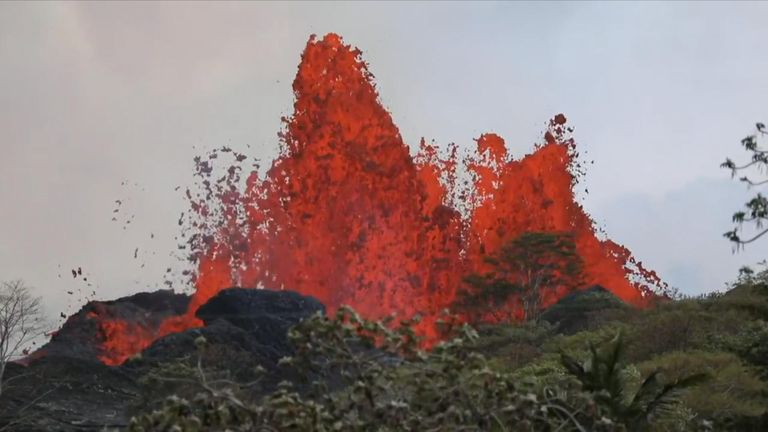 Lava streams from an underground chamber below a fissure