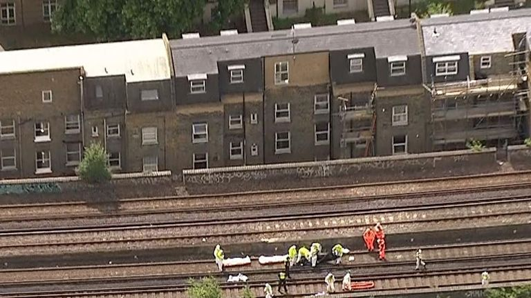 Emergency workers on the track where the bodies were found