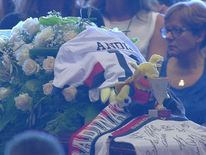 Victims' families blame former government at state funeral