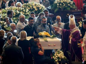 Cardinal Angelo Bagnasco blessed each coffin, including this one of the youngest victim, a boy, eight
