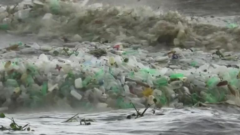 Tons of plastic churns through waves on South African beach