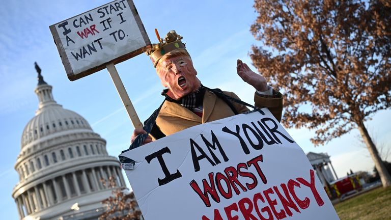 A demonstrator dressed as Donald Trump at an anti-war rally in Washington DC