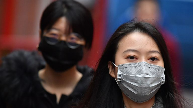 "Pedestrians wear surgical masks in London's China Town on January 24, 2020. - European airports from London to Moscow stepped up checks Wednesday on flights from the Chinese city at the heart of a new SARS-like virus that has killed 17 people and spread to the United States. Britain advised against ""all but essential travel"" to Wuhan -- the central China city from where the virus spread -- while European health authorities put the threat of the virus spreading to ""moderate"". The coronavirus has sparked alarm because of its similarity to the outbreak of SARS (Severe Acute Respiratory Syndrome) that killed nearly 650 people across mainland China and Hong Kong in 2002-03. The new virus emerged on the eve of the Lunar New Year holiday during which hundreds of million travel across China to meet up with their families. (Photo by Ben STANSALL / AFP) (Photo by BEN STANSALL/AFP via Getty Images)"