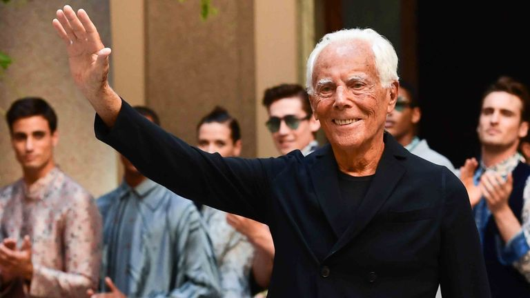 Italian fashion designer Giorgio Armani acknowledges applause following the presentation of fashion house Armani's women's and men's spring/summer 2020 fashion collection in Milan on June 17, 2019. (Photo by Miguel MEDINA / AFP)        (Photo credit should read MIGUEL MEDINA/AFP via Getty Images)