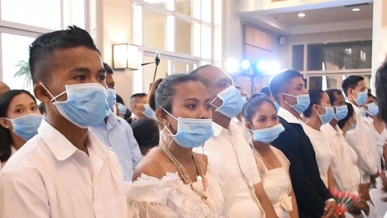 Hundreds of couples wearing facemasks tied the knot at a mass wedding in the Philippines on Thursday amid the threat of the COVID-19 disease.