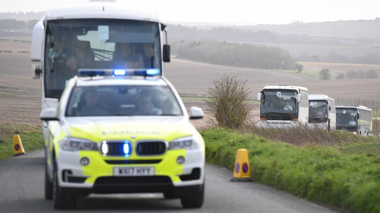 The passengers are escorted by police to Arrowe Park Hospital on the Wirral